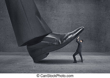 big foot stepping on businessman