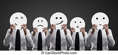 businessmen holding smiles - businessmen hold plates with...