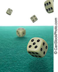 Let\\\'s roll - Five dices rolling over a green felt.