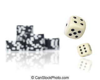 Rolling dices - Pair of dice rolling in front of stacked...