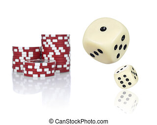 Rolling dices - Pair of dice rolling in front of stacked red...