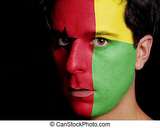 Flag of Guinea-Bissau Painted on a Face of a Young Man