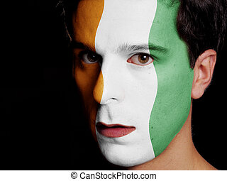 Flag of Ivory Coast Painted on a Face of a Young Man