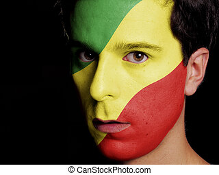 Flag of Republic of the Congo Painted on a Face of a Young...