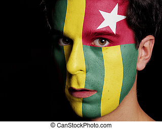 Flag of Togo Painted on a Face of a Young Man