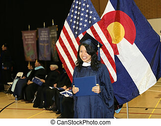 Proud Graduate - Beautiful young Asian woman proudly shows...
