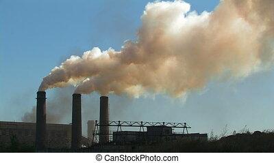 Three smoking chimneys Long shot, locked down Metallurgical...