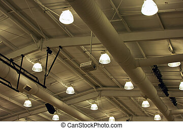 industrial ceiling - looking up at lights and air ducts on...