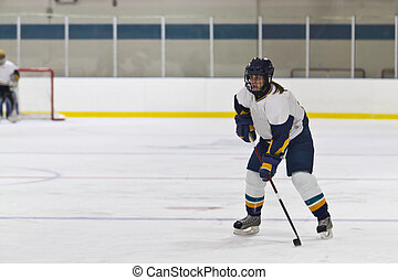 Woman ice hockey player during a ga