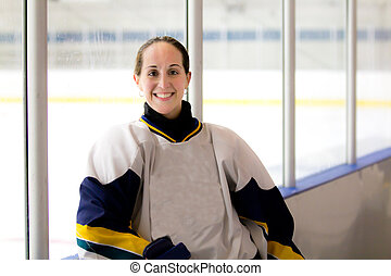 Female ice hockey player after a ga