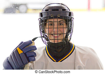 Female ice hockey player with helme