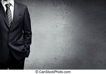 businessman in suit on a concrete background