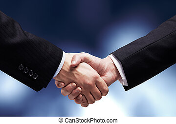handshake - two young businessmen shaking hands