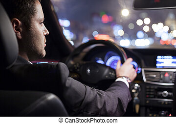 businessman driving car - businessman driving a car at night