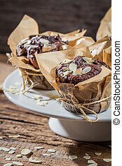 Plate full of chocolate muffins with almonds