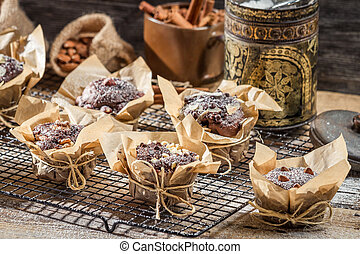 Chocolate muffins with nuts and icing sugar