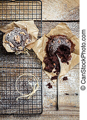 Closeup of tasting freshly baked chocolate muffins