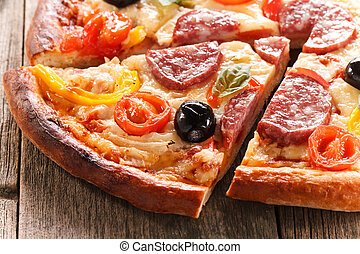 Pizza on wood texture background