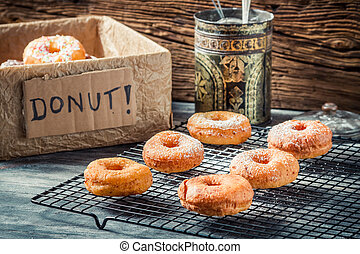 Preparing to decorate donuts with powder sugar