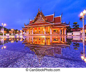 Monarchs chancel temple at twilight with reflection in a...