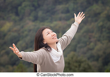 woman outstretched hands - Asian woman outstretched hands...