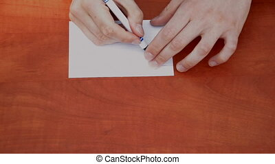 Handwritten words Do It on white paper sheet