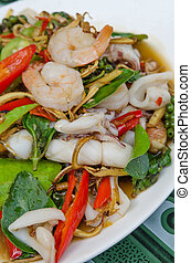 spicy seafood dish , fried shrimp and squid with herbal...