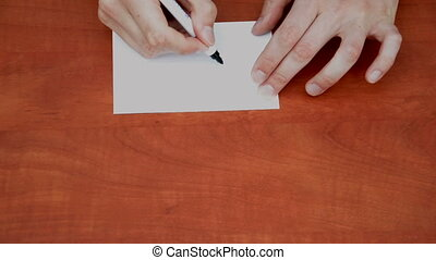Handwritten words Get Out on white paper sheet