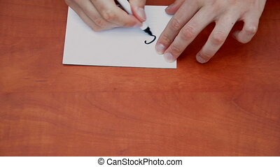 Handwritten word Silence on white paper sheet