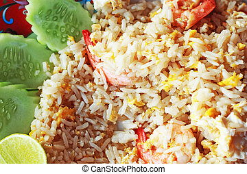 Fried rice with shrimp on the plate.