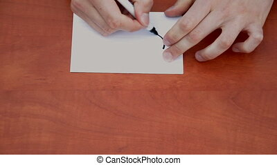 Handwritten word Urgent on white paper sheet