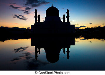 Silhouette of a mosque - Silhouette and reflection of a...
