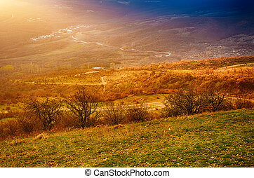 Rural landscape with sun rays