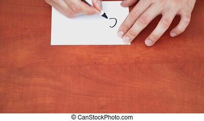 Handwritten word Contract on white paper sheet