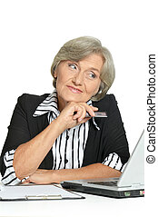 Mature businesswoman working with computer