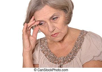 Sad elderly woman portrait - Close-up portrait of an elder...