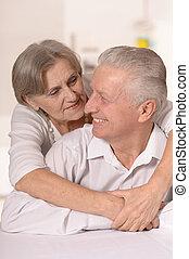 Portrait of a happy senior couple. - Close-up portrait of a...