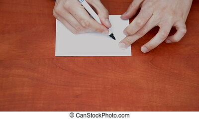 Handwritten word Email on white paper sheet