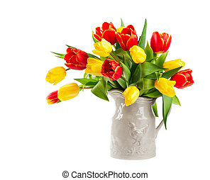 Red and yellow tulips in a jug