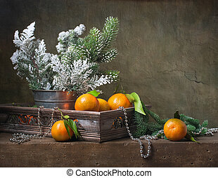 Christmas vintage still life with tangerines and christmas...
