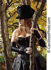 Cosplayer in the autumn park