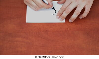 Handwritten words Go Away on white paper sheet