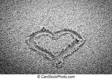 Heart shape on sand. Romantic, black and white, hand drawn.