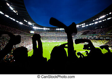 Football, soccer fans support their team and celebrate goal,...