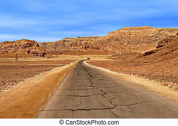 Road through red mountains in Timna park. - Paved road...