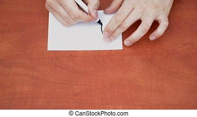 Handwritten word Left on white paper sheet