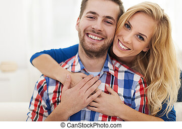 Portrait of happy embraced couple