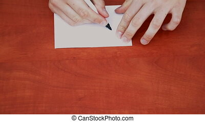 Handwritten word Play on white paper sheet