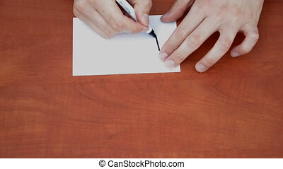 Handwritten word Please on white paper sheet