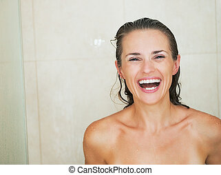 Portrait of smiling young woman in shower